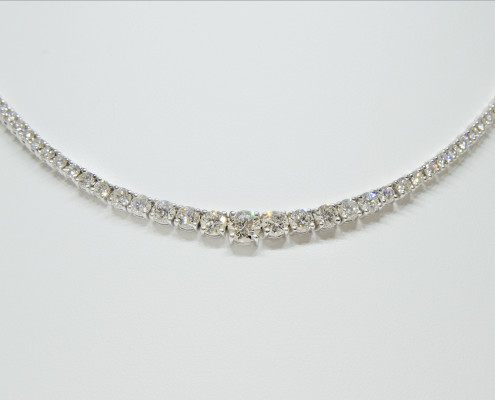 14Kt White Gold Necklace with 5.92cts of Diamonds Set in Prongs. Center Stone is .55ct, and GIA certified, HVS2. MKL 1304